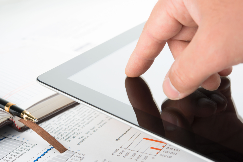 Hand touching screen of tablet pc