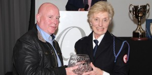Carer, John Barry, receives his award from Marie McSweeney, Cork Area Health & Social Care Officer