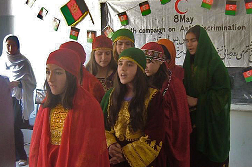 Afghanistan. Schoolgirls participate in Afghan Red Crescent anti-discrimination activities for young people on World Red Cross Red Crescent Day. © Afghan Red Crescent Society