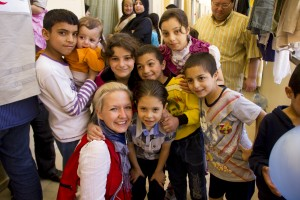 Mari with internally displaced Syrians at a sports center thar serves as a shelter for 300 people and a distribution point for food. In Photo: Mari A. Mørtvedt/ Red Cross
