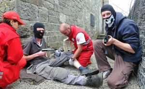 Hostage Scene at FACE 2012, Dundalk — with Marta Figurska, David Stackpool, Апостол Караганчев, Bulgarian Red Cross and Joseph Stackpool. (note: Patients and men with weapons are actors for FACE 2012)