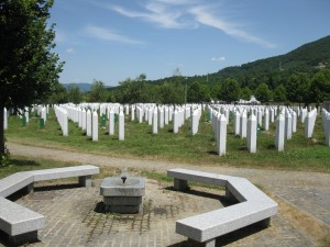Rows of white posts mark the graves of thousands of victims of the Srebrenica Massacre.