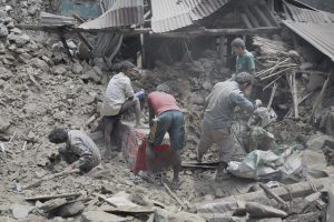 digging in rubble after the devastating Nepal earthquake of 2015