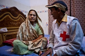 Red Cross volunteer Sardam visiting one of his patients to make sure that she his taking her treatment correctly. Sheela is 65 and has just finished her treatment and is now cured.