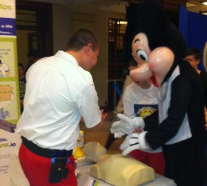 Irish Red Cross Volunteer Conor Allen Teaches Mickey Mouse CPR at the 2012 Voluntary Emergency Services Exhibition, Cork, Ireland