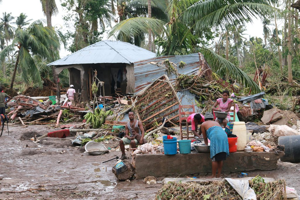 Cayes, southern Haiti, October 6, 2016. Hurricane Matthew has struck Haiti. Immediate aftermath. Red Cross teams assess the situation with authorities and other organizations.  Damage to houses, structures, flooded streets, people outside.